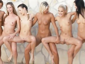Nude Art Models Pose Erotically In A Group