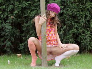 Skinny Teen Beauty Flashing In The Garden